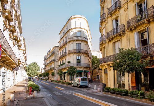 Street view with beautiful old luxurois buildings on the Foch boulevard during the morning light in Montpellier city in Occitanie region of France