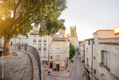 Fototapeta Street view with saint Pierre cathedral at the old town of Montpellier city in Occitanie region of France