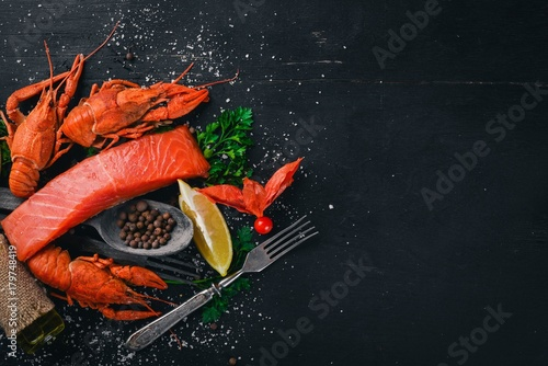 Seafood. Fish Vomer, lobster, salmon. On a wooden background. Top view. Free space for text. - 179748419