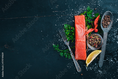 Salted salmon. Seafood. On a wooden background. Top view. Free space for your text. - 179749609