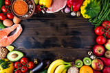 Background healthy food. Fresh vegetables, fruits, meat and fish on wooden table. Healthy food, diet and healthy life concept. Top view, copy space - 179755461