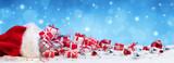 Red Bag With Christmas Present On Snow - 179760486