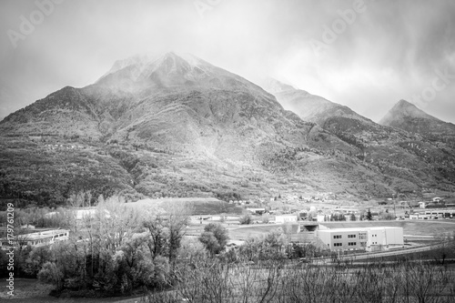Fotobehang Grijs bad weather, autumn landscape in black and white. Mountain in autumn