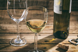White wine glass on wooden background - 179766644