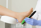 Orthopedic insoles. Fitting orthotic insoles. Flatfoot treatment. Podiatry clinic. - 179771239