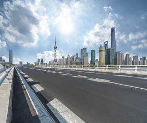 road through the bridge with city skyline background