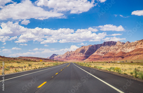 Fotobehang Route 66 Picturesque road in Arizona. red stone cliffs and blue sky
