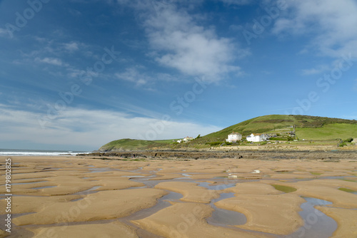 Low tide on beach at Croyde, North Devon Poster
