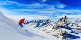 Man skiing on fresh powder snow with Matterhorn in background, Zermatt in Swiss Alps. - 179805649