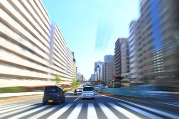 Car driving fast in Tokyo