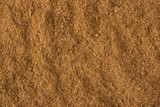 ground nutmeg powder spice as a background, natural seasoning texture - 179813899