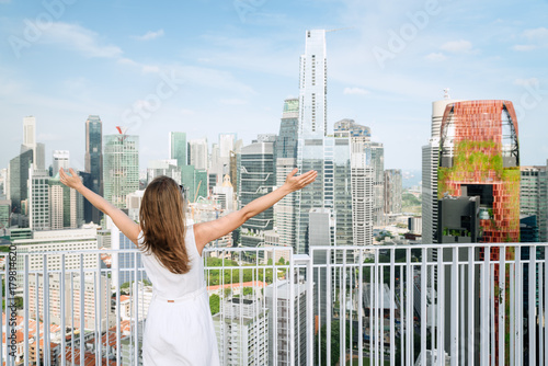Young woman at rooftop of high-rise building in Singapore