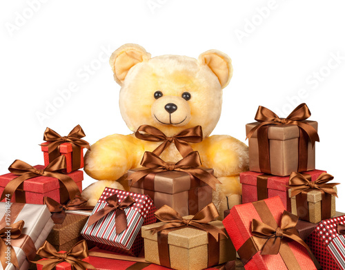 teddy bear and a lot of boxes with gifts isolated