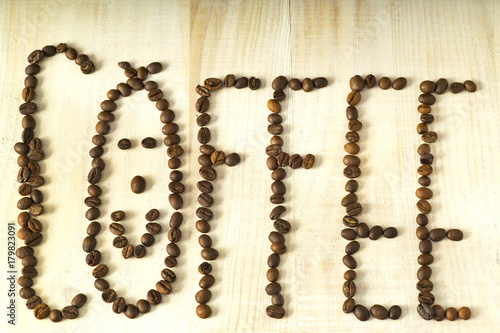 Papiers peints Café en grains coffee beans writing the word coffee with smile