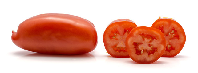 One whole San Marzano tomato and three rings isolated on white background