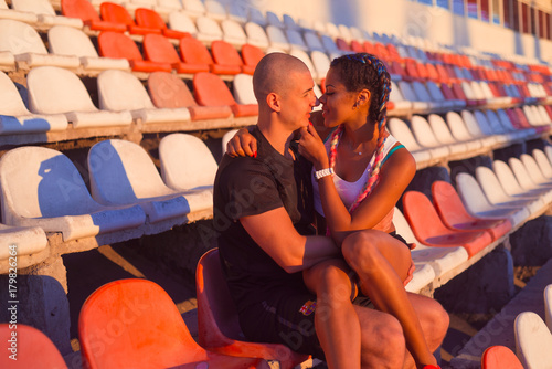 A guy and a girl at the stadium are engaged in sports, lifestyle Poster