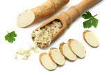 sliced horseradish root with parsley isolated on white background - 179828868