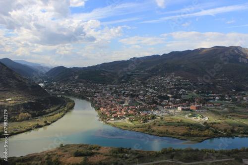 Fotobehang Groen blauw the confluence of two rivers Mtkvari and Argue in Mtskheta