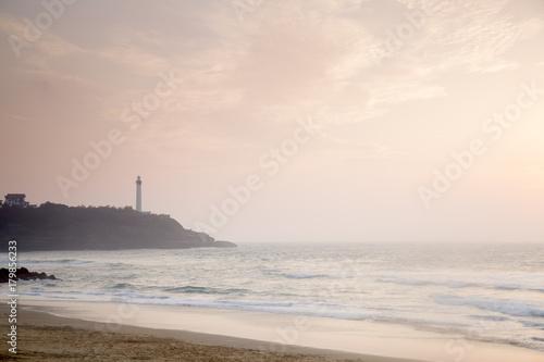 Fotobehang Vuurtoren Lighthouse and Beach at Sunset, Biarritz