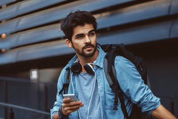 Young handsome man using smartphone outdoor
