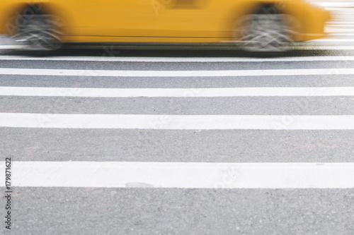 Deurstickers New York TAXI Abstract blur of urban street scene with a yellow taxi cab in New York, United States