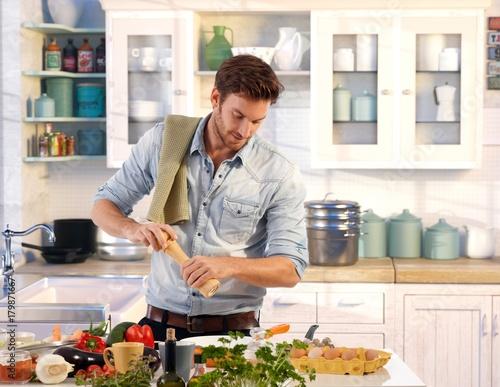 Young man preparing food at home