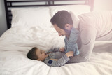 Father and son in bed, happy time on bed - 179874459