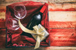 Valentines day. Red wine bottle, glasses and a gift in a box, wooden background with copyspace