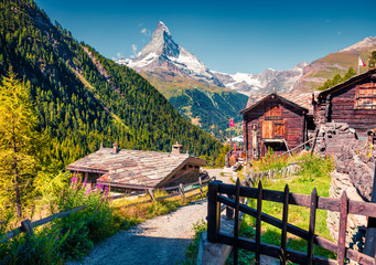 Sunny summer morning in Zermatt village with Matterhorn (Monte Cervino, Mont Cervin) peak on backgroud.