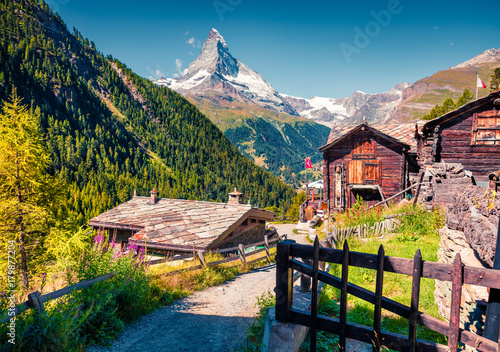 Sunny summer morning in Zermatt village with Matterhorn (Monte Cervino, Mont Cervin) peak on backgroud. © jojjik