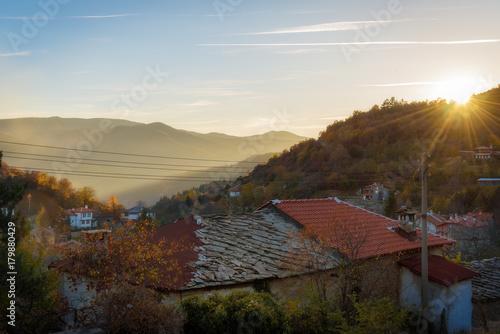 Fotobehang Diepbruine Mountain village