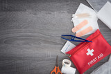 First aid medical kit on wood background,copy space,top view - 179882892