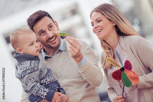 Happy family in the city street