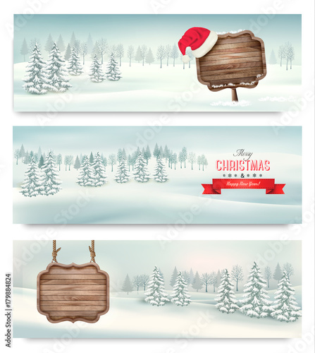 Holiday Christmas banners with winter landscare and wooden sign. Vector. - 179884824