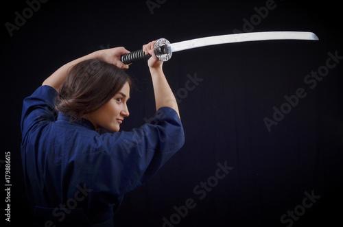 brunette girl in a kimono holding a sword Poster