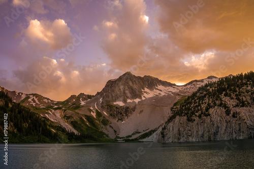 Fotobehang Zwart Sunset over rocky peak