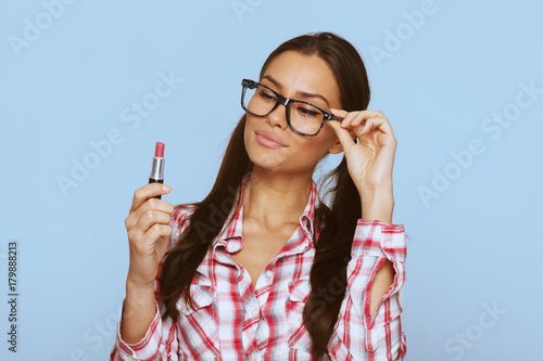 Attractive woman geek holding lipstick in hand Plakat