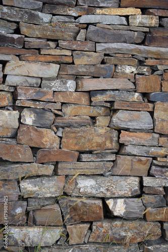 Foto op Canvas Baksteen muur Natursteinmauer