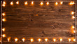 Yellow christmas light over rustic wooden background. Christmas or New Year concept