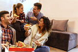 Group of young friends eating pizza.Home party.Fast food concept. - 179890457