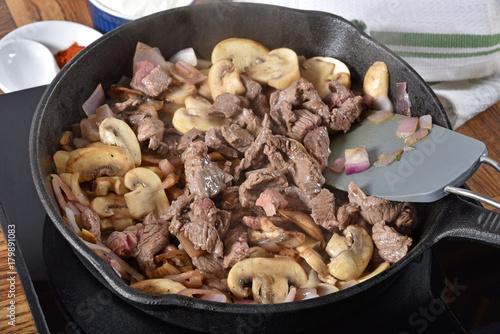 Foto op Plexiglas Steakhouse Steak, mushrooms and onions