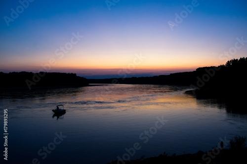 Fotobehang Zee zonsondergang Sunset above the river Danube