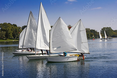Fotobehang Zeilen Sports sailing in Lots of Small white boats on the lake