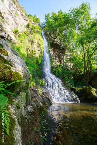 Landscape of one of water cascades of Oneta waterfalls in picturesque forest of Asturias, Spain. - 179902461