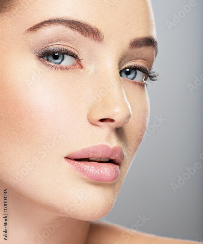 Beautiful face of young woman with perfect skin