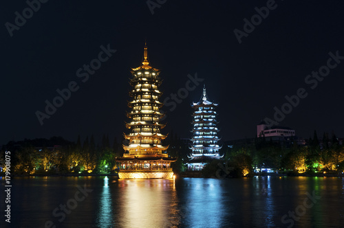 Foto op Canvas Guilin The Sun and Moon Twin Pagodas illuminated at nigh in the city of Guilin, China