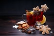 Christmas mulled wine and gingerbread cookies on dark wooden table, copy space. Christmas and New Year traditions, festive food