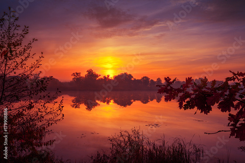 Fotobehang Baksteen Early morning, dawn over the lake. Misty morning, rural landscape, wilderness, mystical feeling