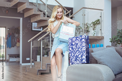 Foto op Canvas Artist KB Pretty lady unboxing her shopping bags
