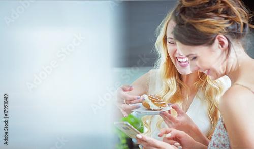 Plexiglas Konrad B. Beautiful girlfreinds enjoying sweets during the summer day